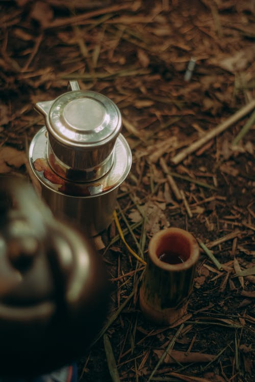 A Silver Pot On The Ground