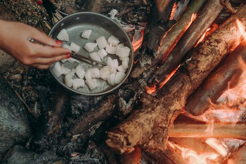 Cooking In A Frying Pan Over A Wood Fire