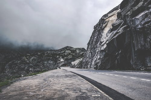 Empty Road Beside Boulder