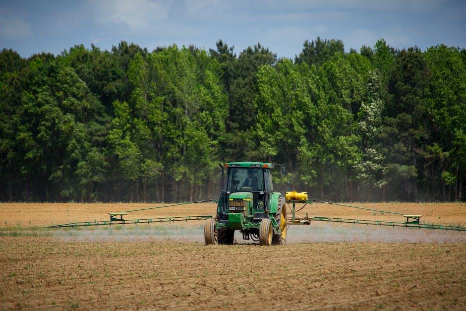 Green tractor in field