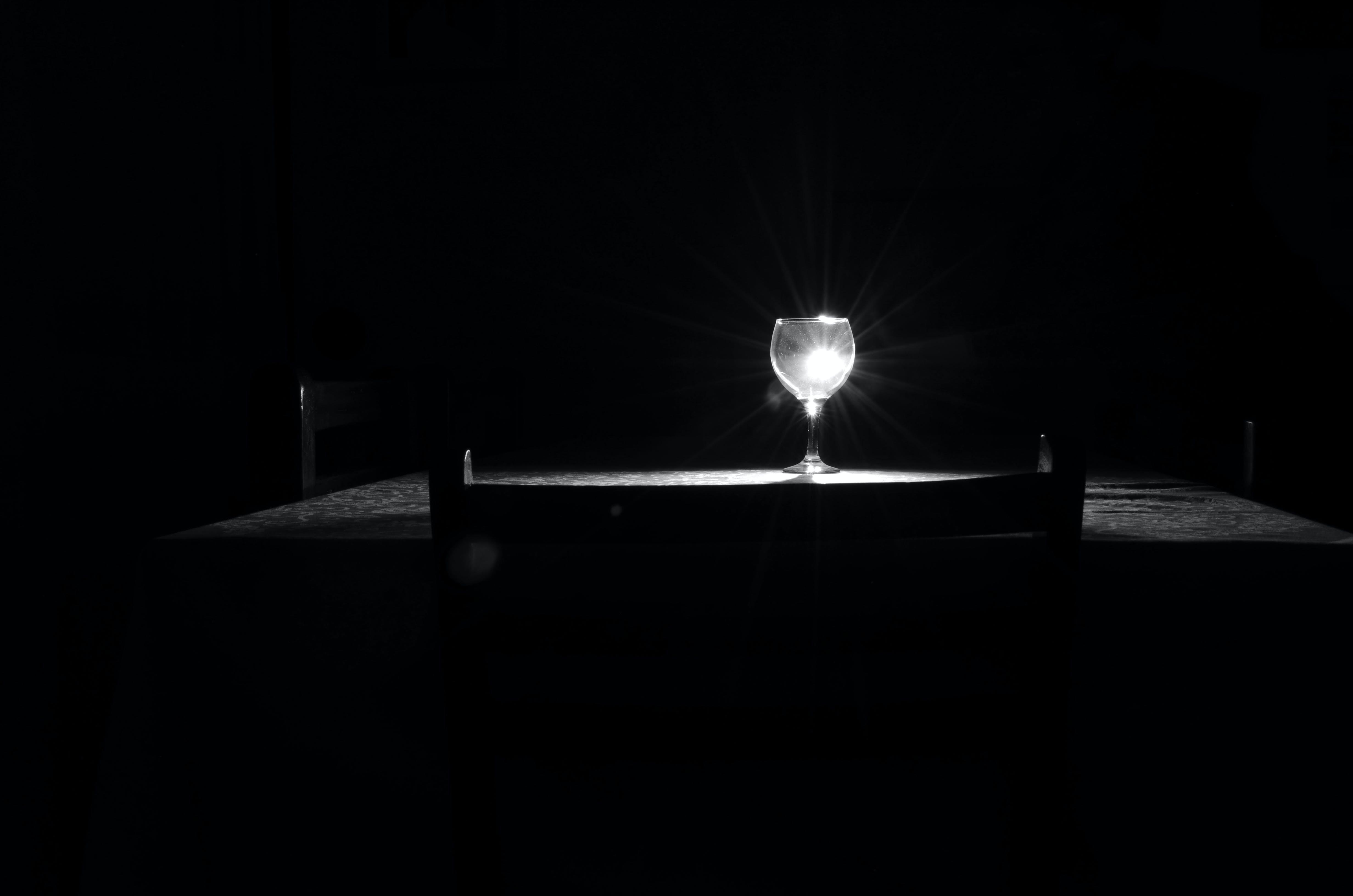 black and white, dark room, dinner table