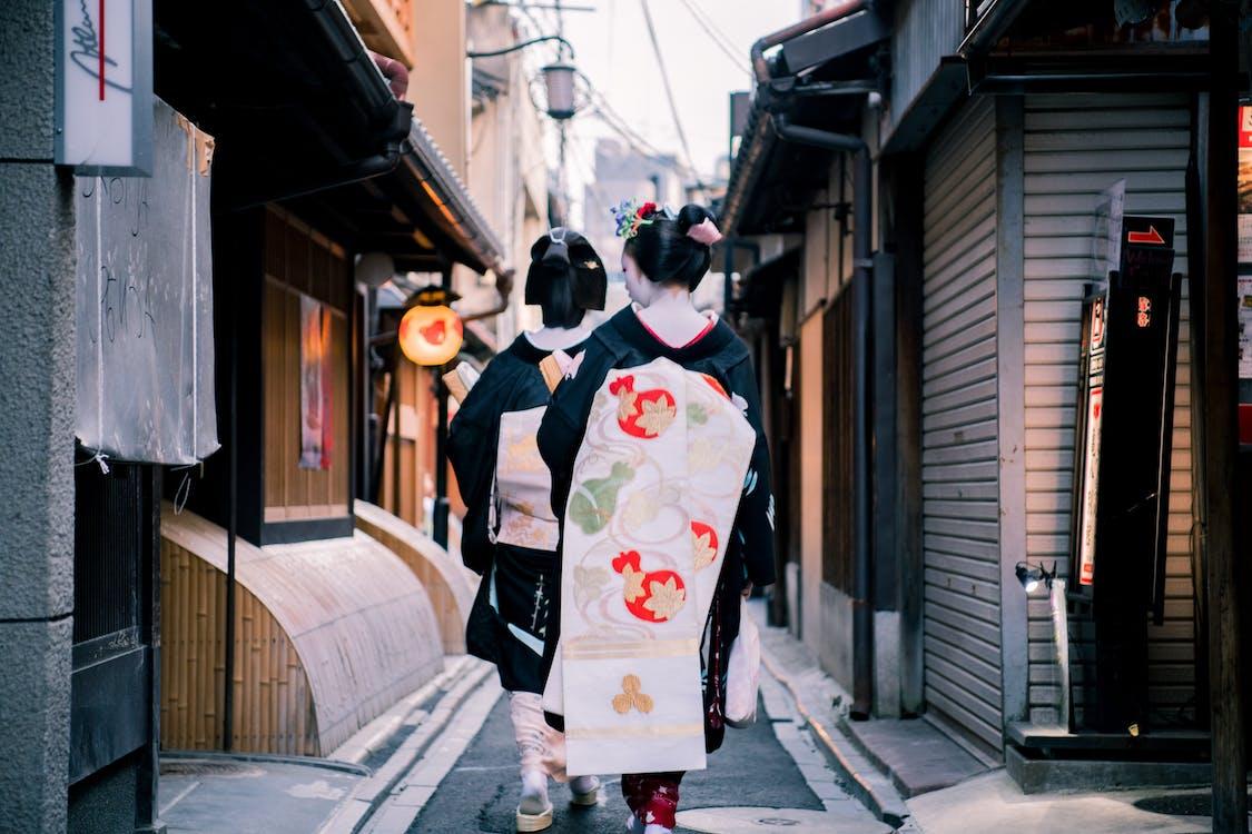 Women Walking on Alley