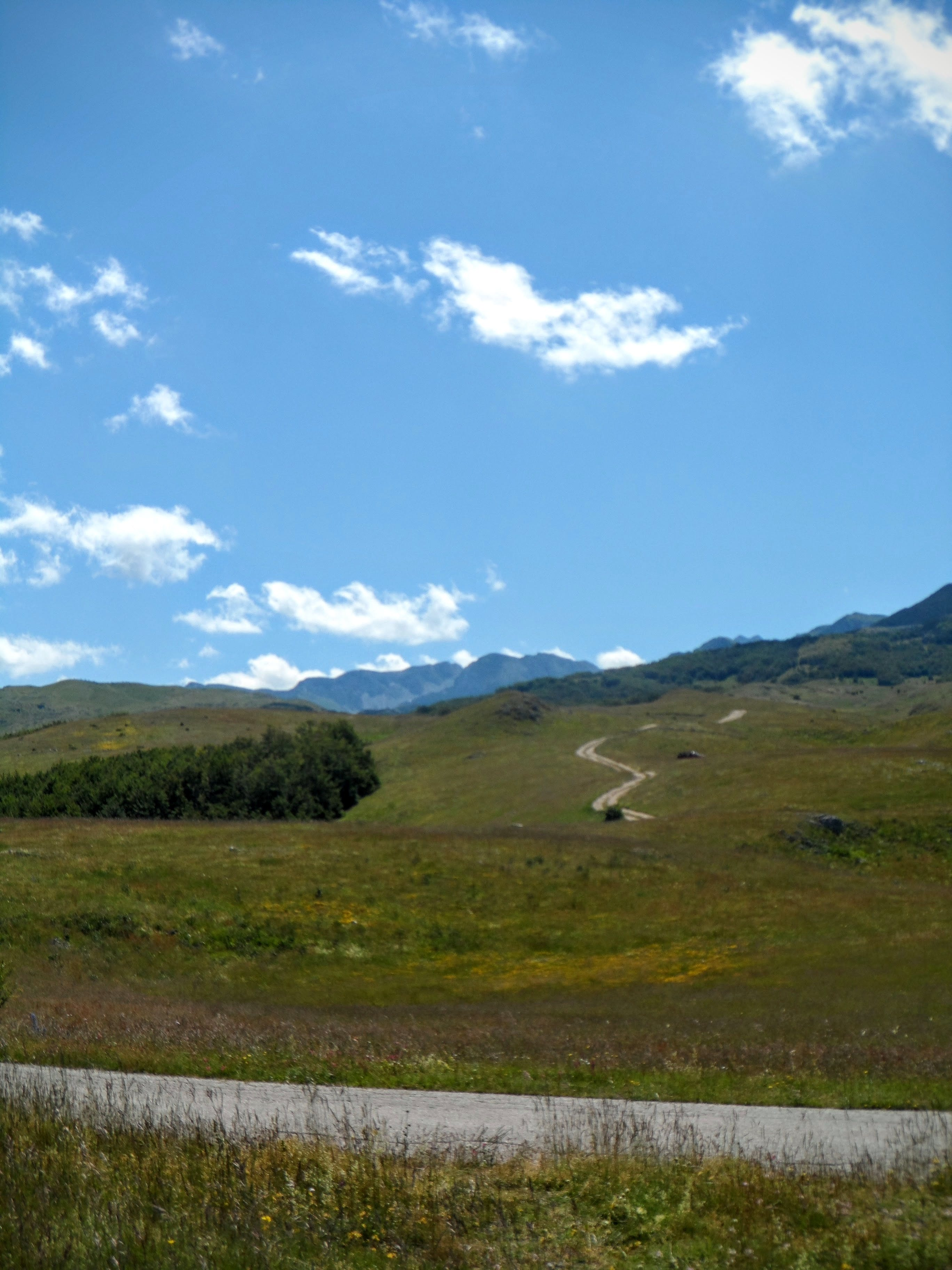 Free stock photo of blue sky, grass, mountain, road