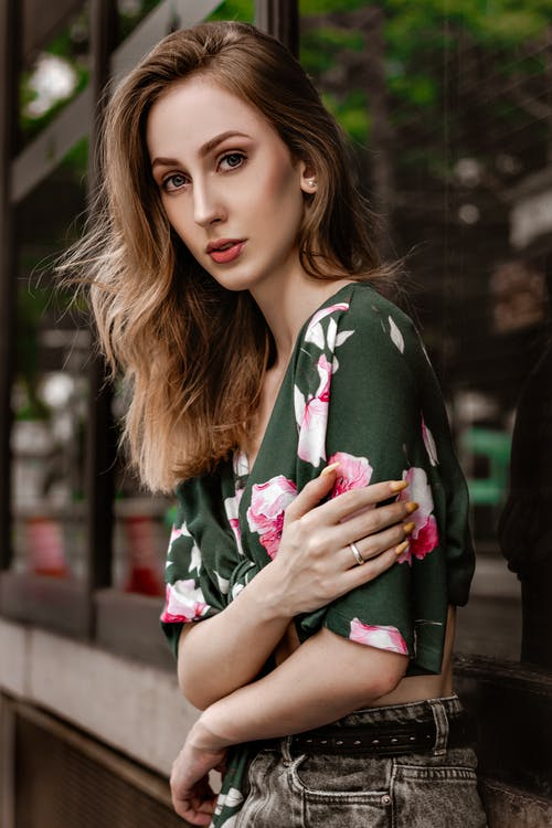 Woman Wearing Green and Pink Blouse