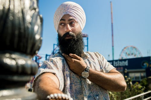 Man Wearing Turban And Printed Shirt