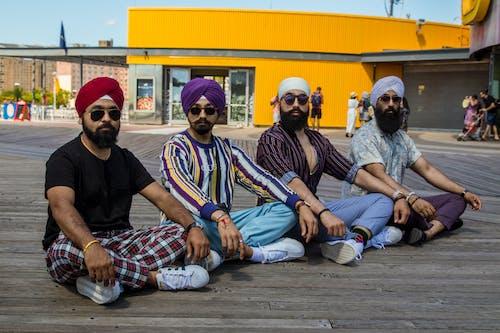 Four Men Sitting on Lotus Position