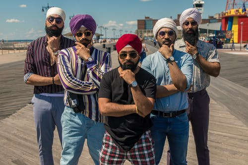 Indian Men in Turbans Posing with Their Hands on the Chin
