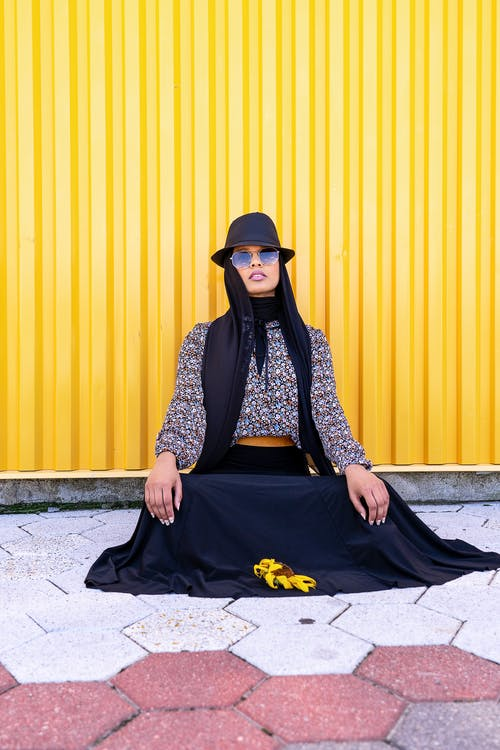 Woman Sitting Concrete Ground
