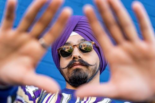 Man Wearing Purple Turban and Black Clubmaster Sunglasses