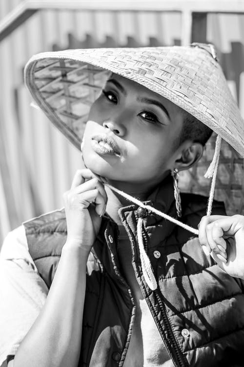 Grayscale Photo of Woman in Bamboo Hat Posing