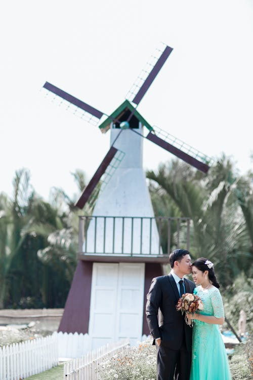 Photo Shoot Of Couple Behind A Windmill