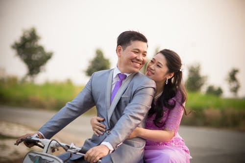 Photo Shoot Of A Wedding Couple Riding A Motorcycle Bike