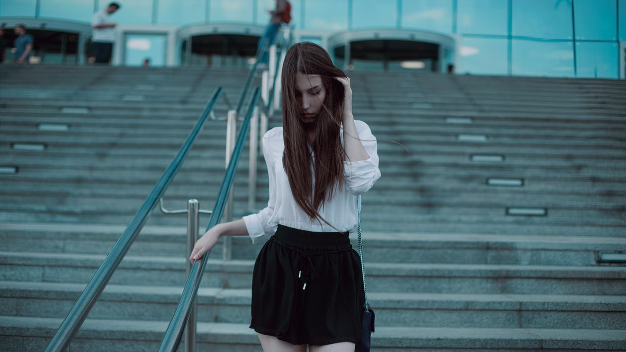 Woman Walking on Concrete Stair