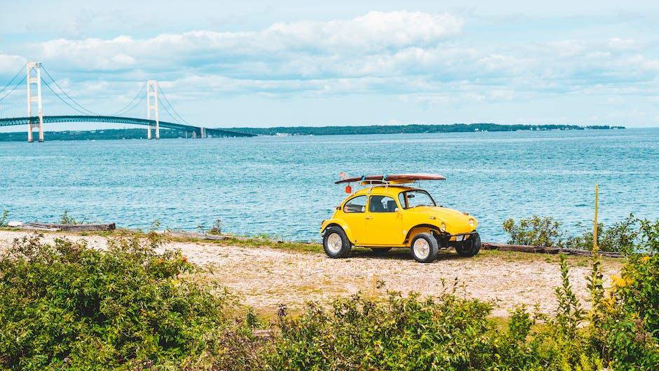Yellow volkswagen beetle on a seaside