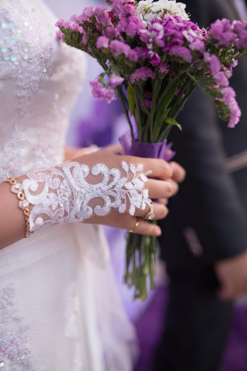 Purple Bouquet On A Bride,s Hand