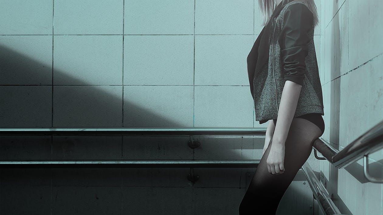 Woman Standing While Wearing Black Jacket