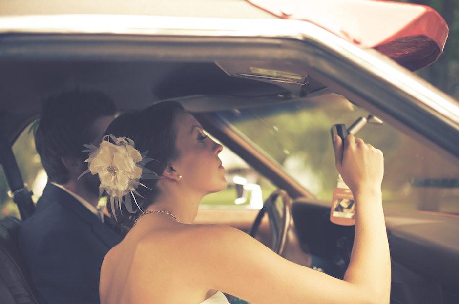 couple, inside car, rearview mirror
