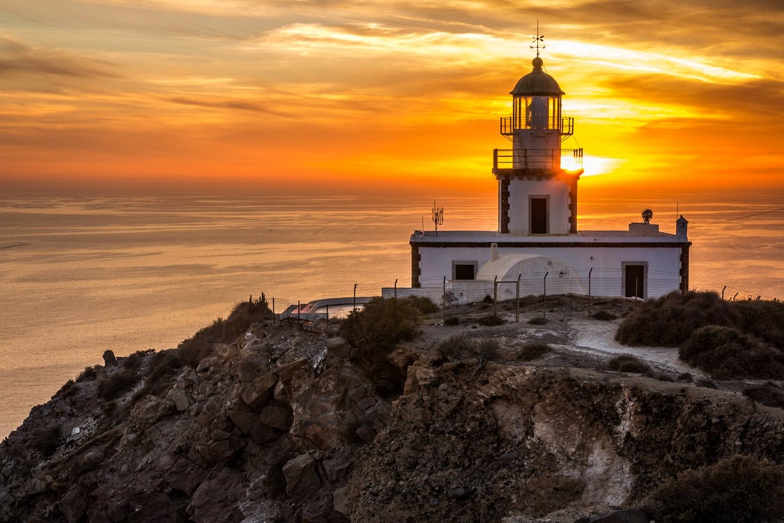 White Lighthouse during Golden Hour