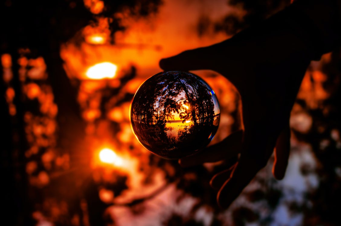 Photo of Person's Hand Holding a Lensball