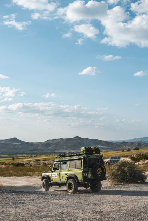 Green Jeep Parked on Dirt Road