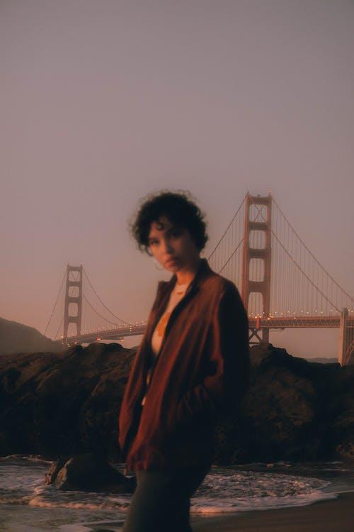 Woman Standing on Seashore Near Golden Gate Bridge