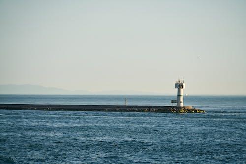 White Lighthouse Beside Ocean