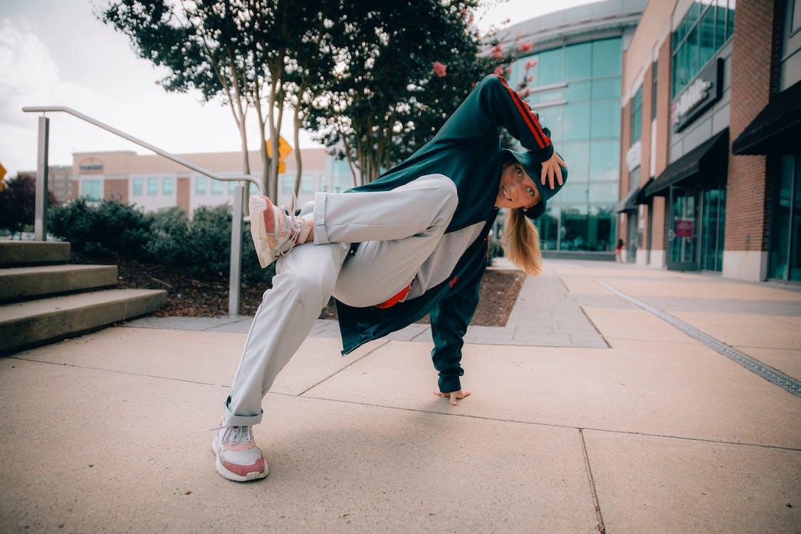 Woman Break-dancing on Concrete Pavement