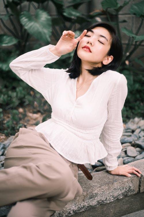 Foto d'estoc gratuïta de a l'aire lliure, assegut, bellesa, bonic
