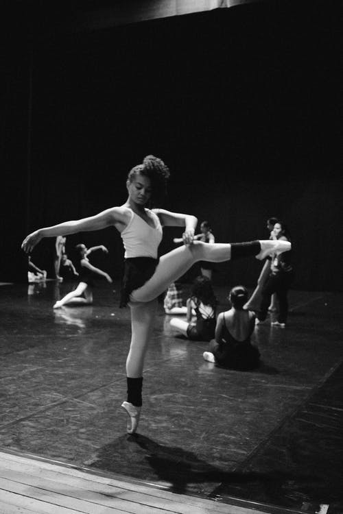 Grayscale Photo of Woman Dancing
