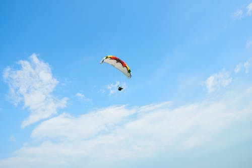 Person Parachuting on Mid Air