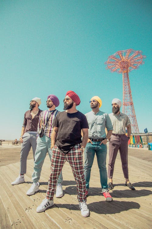Five Men Wearing Assorted-color Turban Headdresses