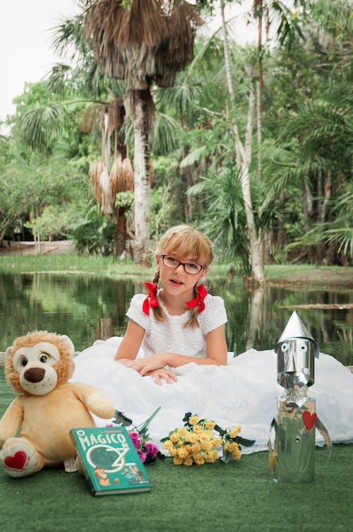 Girl Sitting Near A Lake