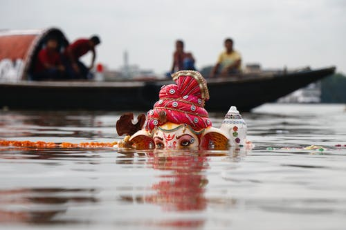 Lord Ganesha Statuette Submerged on Body of Water