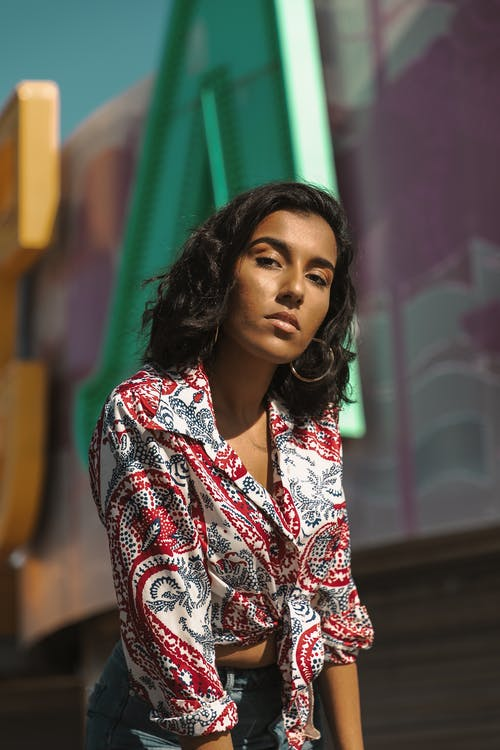 Selective Focus Photo of Woman in Floral Shirt Posing