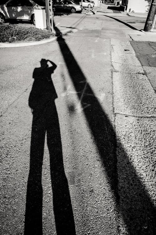 Shadow of a person on Asphalt Road