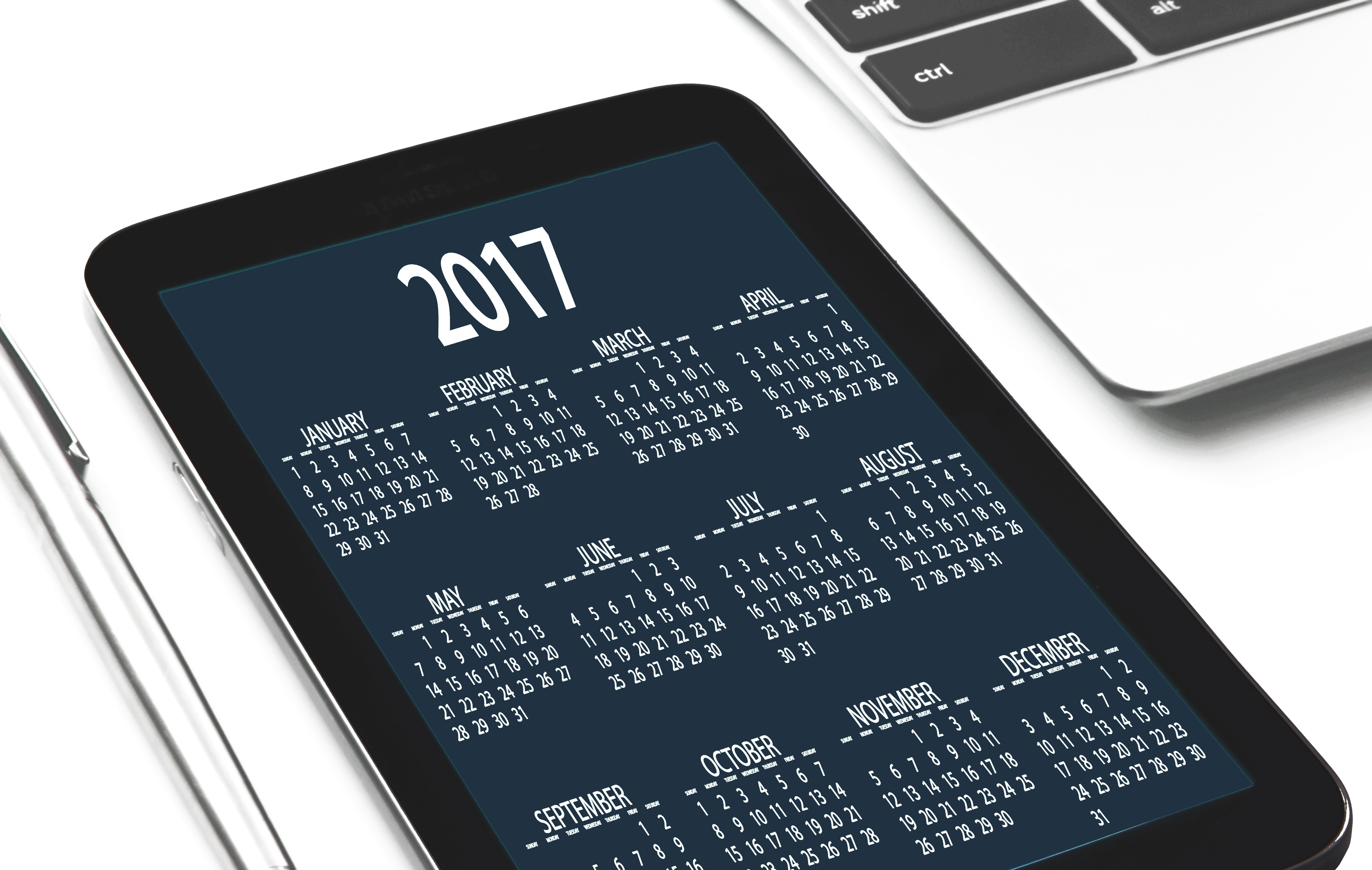 black tablet computer displaying 2017 calendar free stock photo