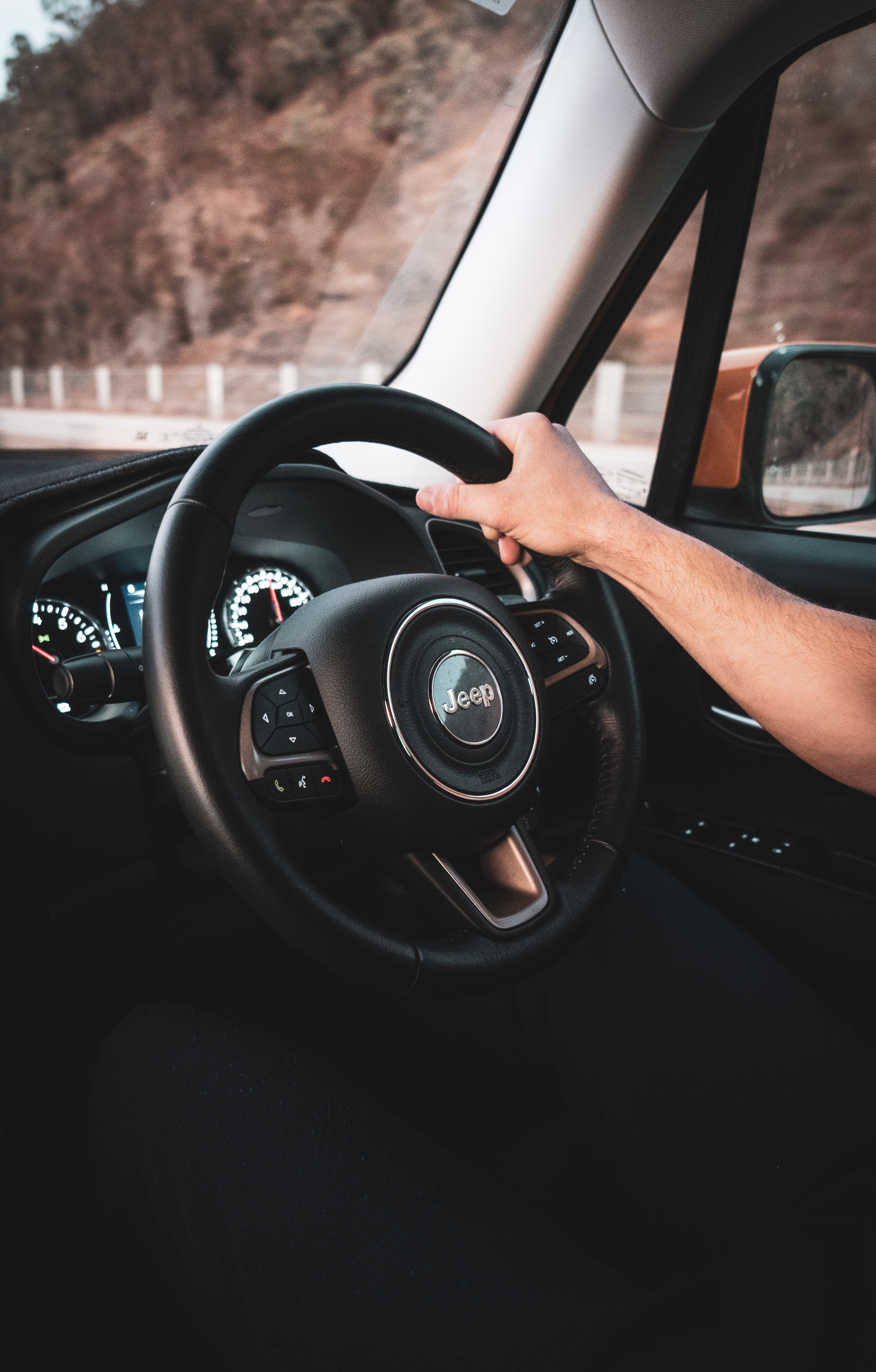 Person's Hand on Jeep Steering Wheel