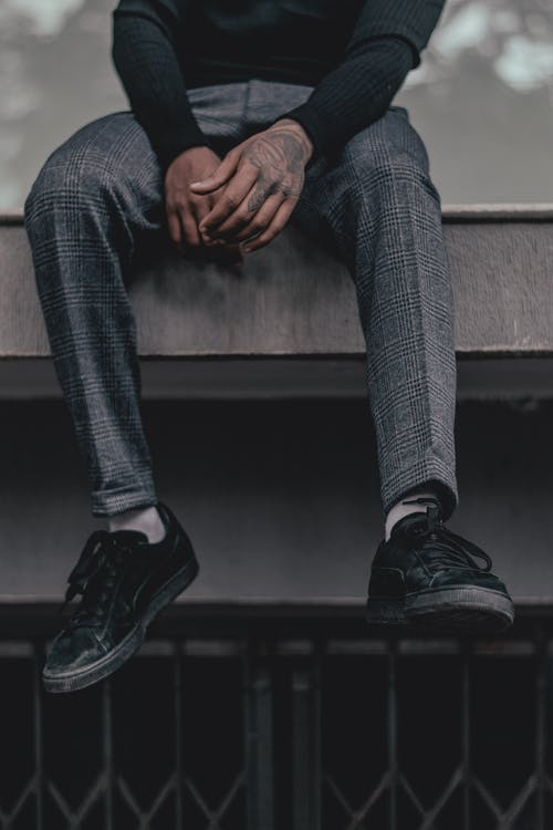 Person Wearing Black Low-top Sneakers