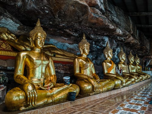Gautama Buddha Statuettes Inside Brown and White Room