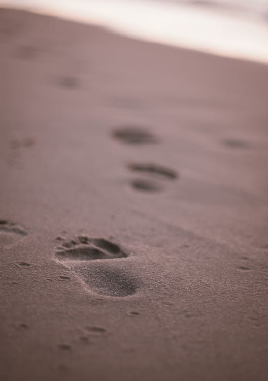 Close-Up Photo of Footprints on Sand