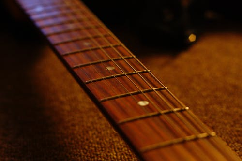 Foto profissional grátis de guitarra elétrica, teclado de guitarra, violão