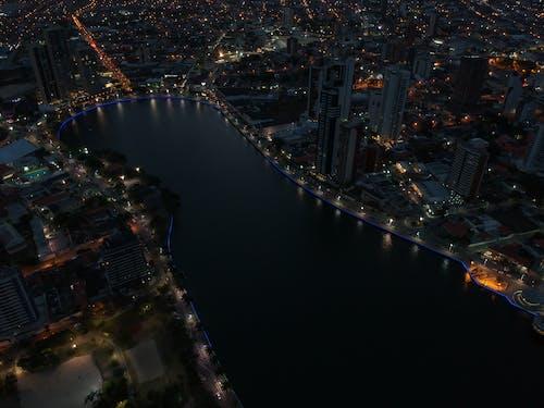 Aerial View of Buildings Beside Body of Water
