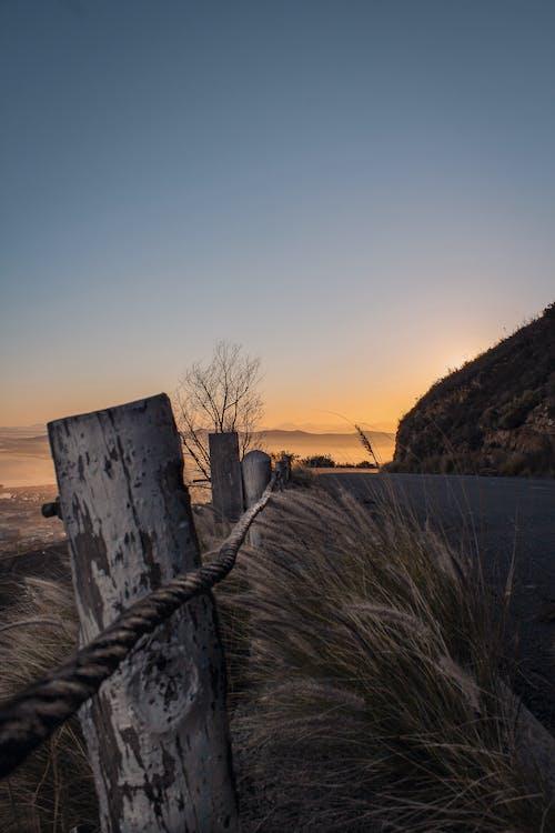 Photos gratuites de aube, automne, barrière, bord de mer