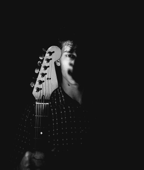 Free stock photo of black and white, checkered shirt, electric guitar, eye shadow