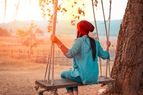 Бесплатное стоковое фото с активный отдых, апельсин, веревка, вид сзади