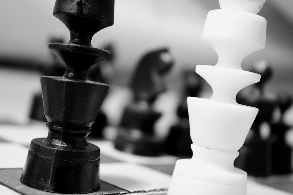 Grayscale Photography of Chess Pawns