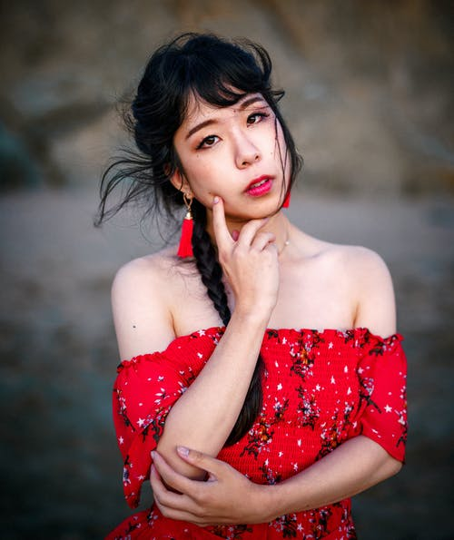 Selective Focus Photography of Woman Wearing Red Off-shoulder Dress