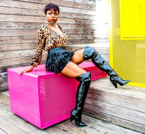 Photo Of Woman Sitting On Pink Box