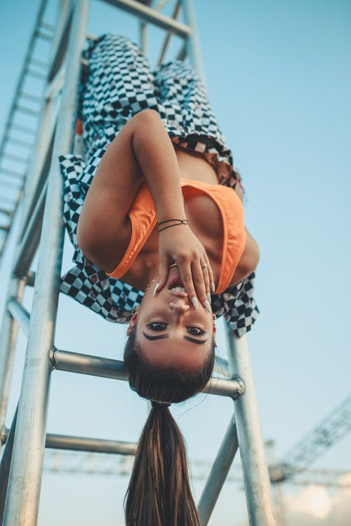 Photo Of Woman Hanging Upside Down