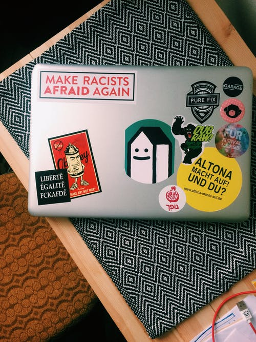 Macbook Pro With Different Stickers
